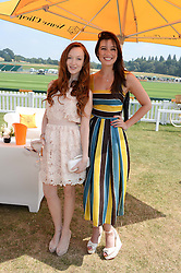 Left to right, OLIVIA GRANT and DAISY LOWE at the Veuve Clicquot Gold Cup, Cowdray Park, Midhurst, West Sussex on 21st July 2013.