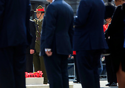© Licensed to London News Pictures 25/04/2013.A New Zealand soldier (left) salutes whilst a Foot Guard stands to attention infront of the Cenotaph where wreaths were laid to mark ANZAC Day..London, UK.Photo credit: Anna Branthwaite/LNP