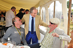 Left to right, PETER FONDA, SIR JACKIE STEWART and CHRIS EVANS and his wife NATASHA at a luncheon hosted by Cartier for their sponsorship of the Style et Luxe part of the Goodwood Festival of Speed at Goodwood House, West Sussex on 5th July 2009.