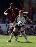 Photo: Olly Greenwood.<br />Arsenal v Tottenham Hotspur. The Barclays Premiership. 22/04/2006. Spurs' Michael Carrick holds off Arsenal's Emmanuel Adebayor.