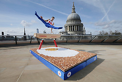 EDITORIAL USE ONLY<br /> Olympic gymnast Max Whitlock performs on a pommel horse over a crash mat made entirely from British Lion eggs in London, as he prepares with a high-protein diet ahead of his participation in the Commonwealth Games, which starts on April 4th in Australia's Gold Coast.