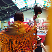 Yolanda La Amorosa is introduced to the crowd as she enters the arena during the 'Titans of the Ring' wrestling group's Sunday performance at El Alto's Multifunctional Centre. Bolivia. The wrestling group includes the fighting Cholitas, a group of Indigenous Female Lucha Libra wrestlers who fight the men as well as each other for just a few dollars appearance money. El Alto, Bolivia, 14th March 2010. Photo Tim Clayton