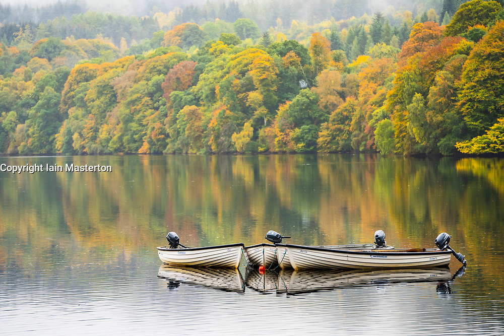 Pitlochry, Scotland, UK. 12 October 2020. Autumn colours on trees and rowing boats on Loch Faskally in Pitlochry.  Iain Masterton/Alamy Live News
