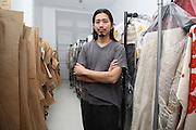 Akira Isogawa amongst his finished garments, Sydney, Australia..28.03.08