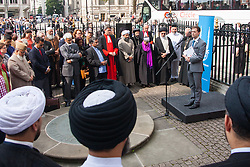 """Westminster Abbey, London. September 3rd 2014.  Leaders of different faiths meet at Westminster Abbey in London to hold a vigil for Iraq organised by World Jewish Relief, Islamic Relief, & Christian Aid, attended by the Most Rev & Rt Hon Justin Welby, Archbishop of Canterbury, Imam Ibrahim Mogra, Ayatollah Dr Sayed Fazel Milani,  Rabbi Laura Janner-Klausner and other senior religious leaders from across the country, where they unfurled a banner stating """"We are all human"""". Pictured: Richard Verber of the World Jewish Relief Fund speaks to the gathering. PAYMENT/CONTACT DETAILS: paul@pauldaveycreative.co.uk Te' +44 (0) 7966 016 296 or +44 (0) 208 969 6875"""