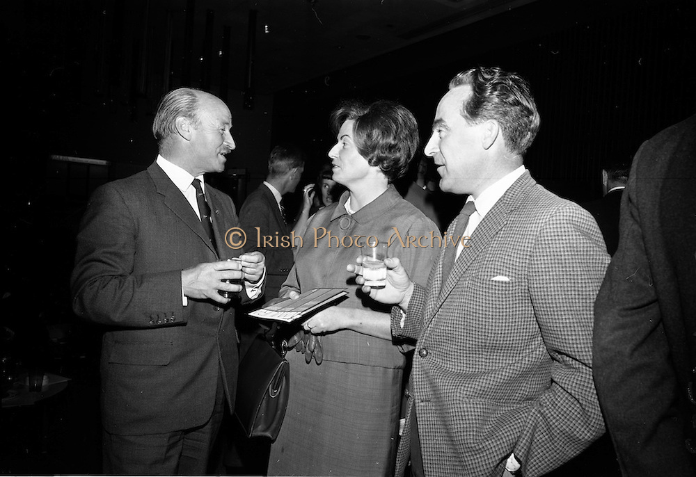 """23/06/1965<br /> 06/23/1965<br /> 23 June 1965<br /> I.C.I. (Imperial Chemical Industries) """"Vymura""""  luxury wall covering (wallpaper?) demonstration at the Intercontinental Hotel, Dublin. Pictured at the event were (l-r) Mr. J.K.D. Lacey, Sales Manager I.C.I. (Ireland) Ltd.; Mary Joan Trimble, architect and Mr. J.J. Connell, architect."""