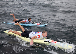 © Licensed to London News Pictures. English Channel. UK 27/07/2011.Nick Thorn (L) and Dave Manley (R) pictured. Surf Relief UK paddlers Dave Manley, Nick Thorn, Phil Williams and Toby Lowe paddle surf boards across the 22 miles of the English Channel from Shakespeare Beach, Dover to Cap Gris Nez in France yesterday (26/07/2011). The team smashed their previous predicted 6 hour time, crossing in 5 hours 20 minutes. The team will raise more than £3000 for Surf Relief UK which provides surfing lessoms for disabled and disadvantaged children across the UK. Photo credit: Manu Palomeque/LNP