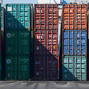 Nederland Zuid-Holland Rotterdam  27-08-2009 20090827 Foto: David Rozing .Serie over logistieke sector.ECT Delta terminal in de haven van Rotterdam. Containers op de overslaglokatie staan klaar om op een schip geladen te worden. .ECT,European Container Terminals, at the Port of Rotterdam. Europe's biggest and most advanced container terminal operator, handling close to three- quarters of all containers passing through the Port of Rotterdam. ECT is a member of the Hutchison Port Holdings group (HPH), the world biggest container stevedore with terminals on every Continent. At the ECT Delta Terminal unmanned, automated guided vehicles  so called AGVs  transport the containers between ship and stack. In the stack, unmanned automated stacking cranes ( ASCs ) ensure that the containers are always stacked in the correct place. Terminal operations are highly automated for discharging and loading large volumes...Holland, The Netherlands, dutch, Pays Bas, Europe .Foto: David Rozing