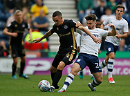Shaun Williams of Millwall shields the ball from Seán Maguire of Preston North End during the EFL Sky Bet Championship match between Preston North End and Millwall at Deepdale, Preston, England on 23 September 2017. Photo by Paul Thompson.