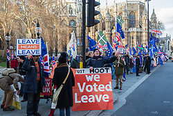 London, UK. 11th December, 2018. Pro- and anti-Brexit activists protest outside Parliament on the day on which a vote was originally to have been scheduled on completion of a House of Commons debate on the Government's draft Brexit withdrawal agreement.