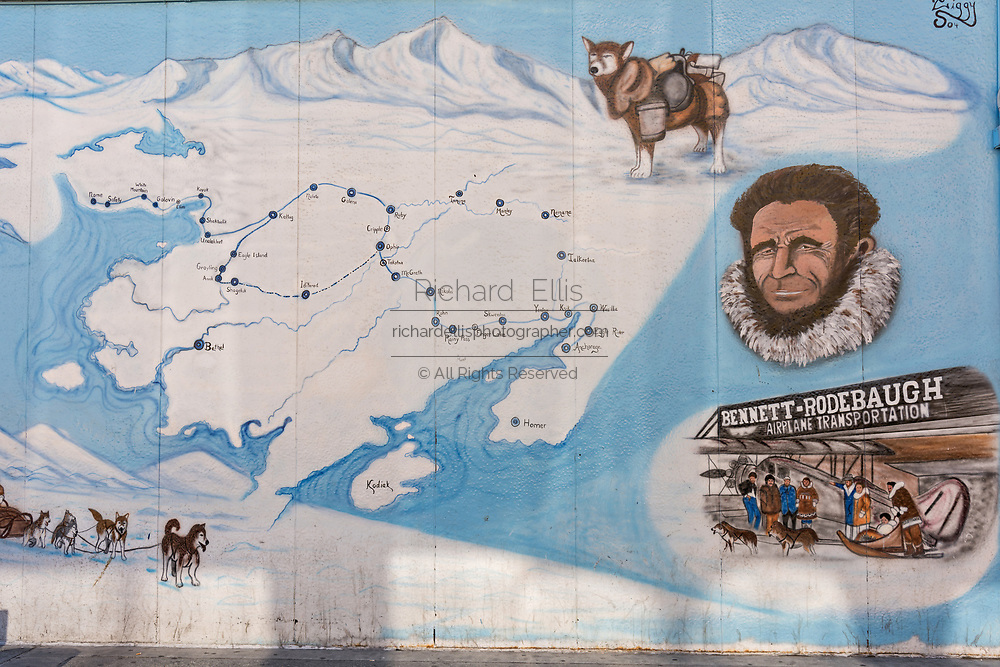 A painted wall mural of the famous Iditarod Trail Sled Dog Race in downtown Anchorage, Alaska.