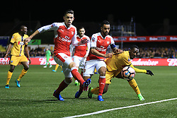 20 February 2017 - The FA Cup - (5th Round) - Sutton United v Arsenal - Roarie Deacon of Sutton United tangles with Gabriel Paulista and Theo Walcott of Arsenal - Photo: Marc Atkins / Offside.