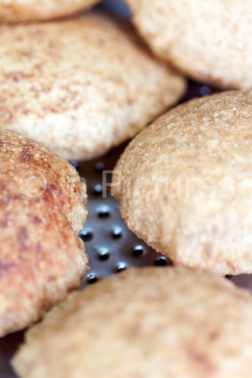 Nagori (small puris) at Ram Swarup, a shop which has been  serving up breakfasts in the old city for over 70 years, Old Delhi, India