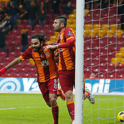 Galatasaray's Burak Yilmaz (R) celebrate his goal with Selcuk Inan (L) during their Turkish Super League soccer match Galatasaray between Balikesirspor at the AliSamiYen Spor Kompleksi TT Arena at Seyrantepe in Istanbul Turkey on Monday, 16 February 2015. Photo by Aykut AKICI/TURKPIX