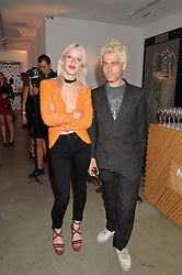 HARRIET VERNEY and TIM NOBLE at the launch of The Lulu Perspective to celebrate 25 years of Lulu Guinness held at 74a Newman Street, London on 13th September 2014.
