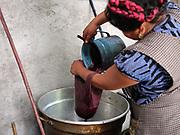 Master dyer Juana Gutierrez Contreras strains cochineal dye in the Zapotec weaving village of  Teotitlan del Valle, Oaxaca, Mexico on 28 November 2018