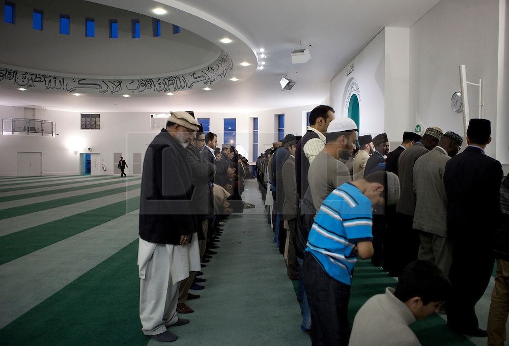 © Licensed to London News Pictures. 24/03/2012. Surrey, U.K..Evening prayers led by Hadhrat Mirza Masroor Ahmad at Europe's largerst mosque, Baitul Futuh Mosque, in Morden, Surrey, which holds 10,000 worshipers. .Parliamentarians and religious, civic, charitable and community leaders meet here this evening 24/3/2012 for a National Peace Symposium on International Peace organised by the Ahmadiyya Muslim community to hear how Muslims are countering extremism..Photo credit : Rich Bowen/LNP
