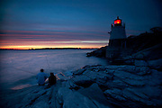 USA, Newport, RI - A couple fishing off the Castle Hill Light house at the mouth of Narragansett Bay