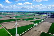 Nederland, Flevoland, Zeewolde, 07-05-2015; Windturbines met bollenvelden in de achtergrond, Prinses Alexia windpark (voorheen windpark De Zuidlob). Het windmolenpark is een initiatief van lokale boeren en Nuon - Vattenfall.<br /> Prinses Alexia wind farm with flower bulb fields in the background. The wind farm in the polder Flevoland is an initiative of local farmers and Nuon - Vattenfall. <br /> luchtfoto (toeslag op standard tarieven);<br /> aerial photo (additional fee required);<br /> copyright foto/photo Siebe Swart
