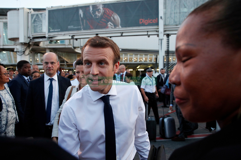 France's President Emmanuel Macron is greeted by officials on the tarmac of Pointe-a-Pitre airport, upon his arrival in the Guadeloupe island, the first step of his visit to French Caribbean islands, Tuesday, Sept. 12, 2017. Photo by Christophe Ena/Pool/ABACAPRESS.COM