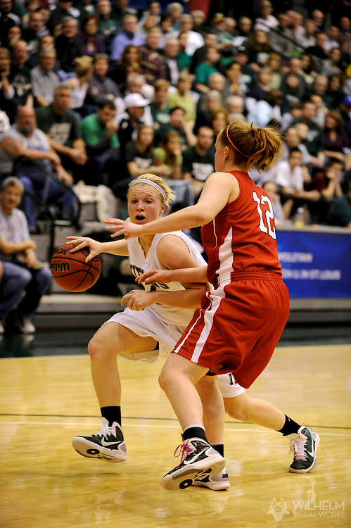 18 MAR 2011: Britt Hasselbring (4) of Illinois Wesleyan University against Claire Schraeperkoetter (12) of Washington University - St. Louis  during the 2011 NCAA Women's Division III <br /> Basketball Championship held on the campus of the Illinois Wesleyan University in Bloomington, IL. Washington - St. Louis defeated Illinois Wesleyan 87-77 to advance to the final. © Brett Wilhelm