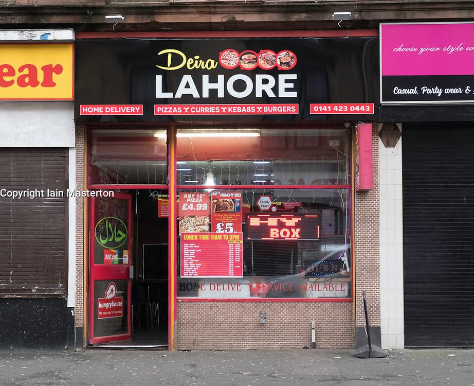 Typical asian take-away restaurant in Govanhill district of Glasgow, Scotland, United Kingdom.