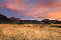 Colorful sunrise over the plains and Rocky Mountains at Waterton Lakes National Park Alberta Canada