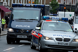 © London News Pictures. 30/05/2013. London, UK.  A police convoy carrying Michael Adebowale arriving at Westminster magistrates court in London. Michael Adebowale as been charged with the murder of soldier Lee Rigby in south-east London last week. A second man accused of murder, Michael Adebolajo, remains under arrest at a London hospital. Photo credit: Ben Cawthra/LNP