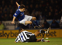 Photo. Matthew Lewis.<br /> Leicester City v Newcastle United. FA Barclaycard Premiership. 26/12/2003.<br /> <br /> Leicester's Muzzy Izzet is tackled by Newcastle's Jermaine Jenas.