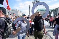 """29 AUG 2020, BERLIN/GERMANY:<br /> Zwei Maenner praesentieren ihre selbst gebastelten Qs, die fuer QAnon stehen, Demonstration gegen die Einschraenkungen in der Corona-Pandemie durch die Initiative """"Querdenken 711"""" aus Stuttgart unter dem Motto """"invites Europa - Fest für Freiheit und Frieden"""", Unter den Linden/Pariser Plastz/Friedrichstrasse<br /> IMAGE: 20200829-01-048<br /> KEYWORDS: Demo, Protest, Demosntranten, Protester, COVID-19, Corona-Demo"""