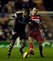 Photo: Jed Wee.<br />Middlesbrough v Charlton Athletic. The Barclays Premiership. 23/12/2006.<br /><br />Charlton's Marcus Bent (L) is tackled by Middlesbrough's James Morrison.