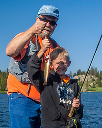 Boys fishing Little Bear Lake in the Beartooth Mountains of Wyoming.