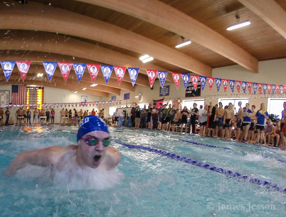 Bedford High School senior Jared Olmeda competes in the 100 yard butterfly during the DCL meet at Atkinson Pool in Sudbury, Jan. 31, 2015.   (Wicked Local Photo/James Jesson)