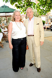 """NICHOLAS & ANNIE COLQUOHOUN-DENVERS at a party to celebrate the publication of the Paper back edition of """"A Lion Called Christian"""" held at Julie's Restaurant & Bar, 135 Portland Road, London W11 on 28th June 2010."""