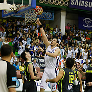 Efes Pilsen's Ermal KURTOGLU (C) and Fenerbahce Ulker's Oguz SAVAS (R) during their Turkish Basketball league Play Off Final second leg match Efes Pilsen between Fenerbahce Ulker at the Ayhan Sahenk Arena in Istanbul Turkey on Saturday 22 May 2010. Photo by Aykut AKICI/TURKPIX