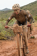 Annika Langvad and Ariane Kleinhans of team RECM2 charge through the mud   during stage 2 of the 2014 Absa Cape Epic Mountain Bike stage race from Arabella Wines in Robertson, South Africa on the 25 March 2014<br /> <br /> Photo by Greg Beadle/Cape Epic/SPORTZPICS