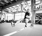 Alpine skier Roni Remme trains on the slack line at the Canadian Sport Institute Calgary high performance training facilities in Calgary, Alberta on August 2, 2017.
