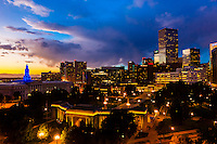 Skyline with City & County Building on left and Civic Center Park in foreground, Downtown Denver, Colorado USA.