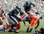 Philadelphia Eagles running back Ryan Mathews (24) leaps over defenders as he scores a late fourth quarter touchdown good for a 29-10 Eagles lead on a one yard dive while Philadelphia Eagles tackle Jason Peters (71) lends support during the 2016 NFL week 1 regular season football game against the Cleveland Browns on Sunday, Sept. 11, 2016 in Philadelphia. The Eagles won the game 29-10. (©Paul Anthony Spinelli)
