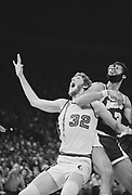 """falconer 0112-1.  """"Bill Walton, on bench, floor, shooting with other players, coach and crowd at end of big win in series. He is key subject in all photos."""" Instructions from Time Magazine. Blazer-Laker NBA game. May 14, 1977."""
