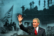 George W. Bush bids farewell to the audience after speaking at the Veterans of Foreign Wars conference in Salt Lake City, Utah, August 22, 2005. Braley/Stock