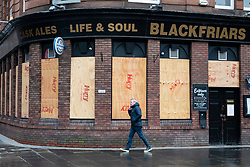 Glasgow, Scotland, UK.1 December 2020. Glasgow remains under level 4 lockdown and non essential businesses, bars and restaurants are closed. Pictured; Blackfriars bar in the Merchant city is closed and boarded up.  Iain Masterton/Alamy Live News