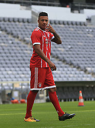 MUNICH, Aug. 8, 2017  Bayern Munich's Corentin Tolisso reacts prior to taking team photos at Allianz Arena in Munich, Germany, on Aug. 8, 2017. Players and coaches of Bayern Munich took team photos for the upcoming German Bundelisga season at Allianz Arena on Tuesday. (Credit Image: © Philippe Ruiz/Xinhua via ZUMA Wire)