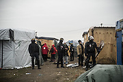 March 1, 2016 - Calais, France -<br /> <br /> Destruction Of Calais Jungle Camp Continues<br /> <br /> Police officers look stand guard as the 'jungle' migrant camp is cleared on March 01, 2016 in Calais, France. Authorities return to clear migrant shelters from more parts of the 'Jungle' migrant camp in Calais and try to move people to shipping containers on another part of the site. French demolition teams began dismantling huts yesterday. Resistance is expected to continue and overnight riot police fired teargas at migrants who were throwing stones. A court ruling on Thursday approved a French Govt plan to clear part of the site. Authorities say approx 1,000 migrants are to be affected out of 3,700 people - many of them refugees from Syria and Iraq - who are thought to live in the camp. Mayor of Calais Natacha Bouchart has demanded the closure of the site for several weeks following several recent clashes with police  <br /> ©Exclusivepix Media