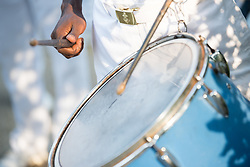 4 December 2017, Abidjan, Côte d'Ivoire: A man plays the drums as part of an orchestra outside the Global Village area of ICASA 2017. The 19th International Conference on AIDS and STIs in Africa (ICASA) 2017 gathers thousands of researchers, medical professionals, academics, activists and faith-based organizations from all over the world, all looking to overcome the HIV epidemic and eliminate AIDS as a public health threat.