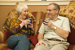 Older couple have a cup of tea,