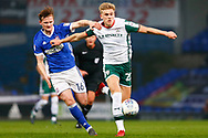 Barnsley midfielder Brad Potts (20) sprints forward Ipswich Town midfielder Callum Connolly (16) battles for possession during the EFL Sky Bet Championship match between Ipswich Town and Barnsley at Portman Road, Ipswich, England on 10 April 2018. Picture by Phil Chaplin.