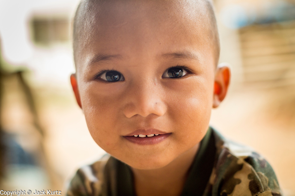 22 MAY 2013 - MAELA REFUGEE CAMP, TAK, THAILAND:  A Burmese boy in Mae La Refugee Camp. Mae La (Maela) is the largest refugee camp for Burmese in Thailand. Over 90% are ethnic Karen. It was established in 1984 in Tha Song Yang District, Tak Province in the Dawna Range area and currently houses 40,000 refugees. The Thai government has indicated that it would like to close the camp and repatriate the refugees to Myanmar as soon as the political situation in Myanmar is stable enough.   PHOTO BY JACK KURTZ