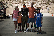 Marosi family poses for a souvenir pictures with their instructors after a 3 hours anti terrorism training.