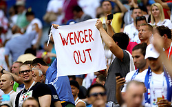 Fans in the stands hold up a Wenger Out banner during the FIFA World Cup, Quarter Final match at the Samara Stadium.